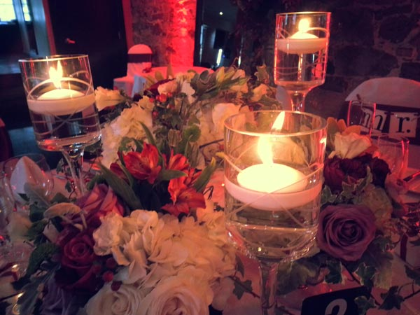 Floating, pillar, votive and tealight candles for wedding centerpiece at Nelligan Hotel Montreal
